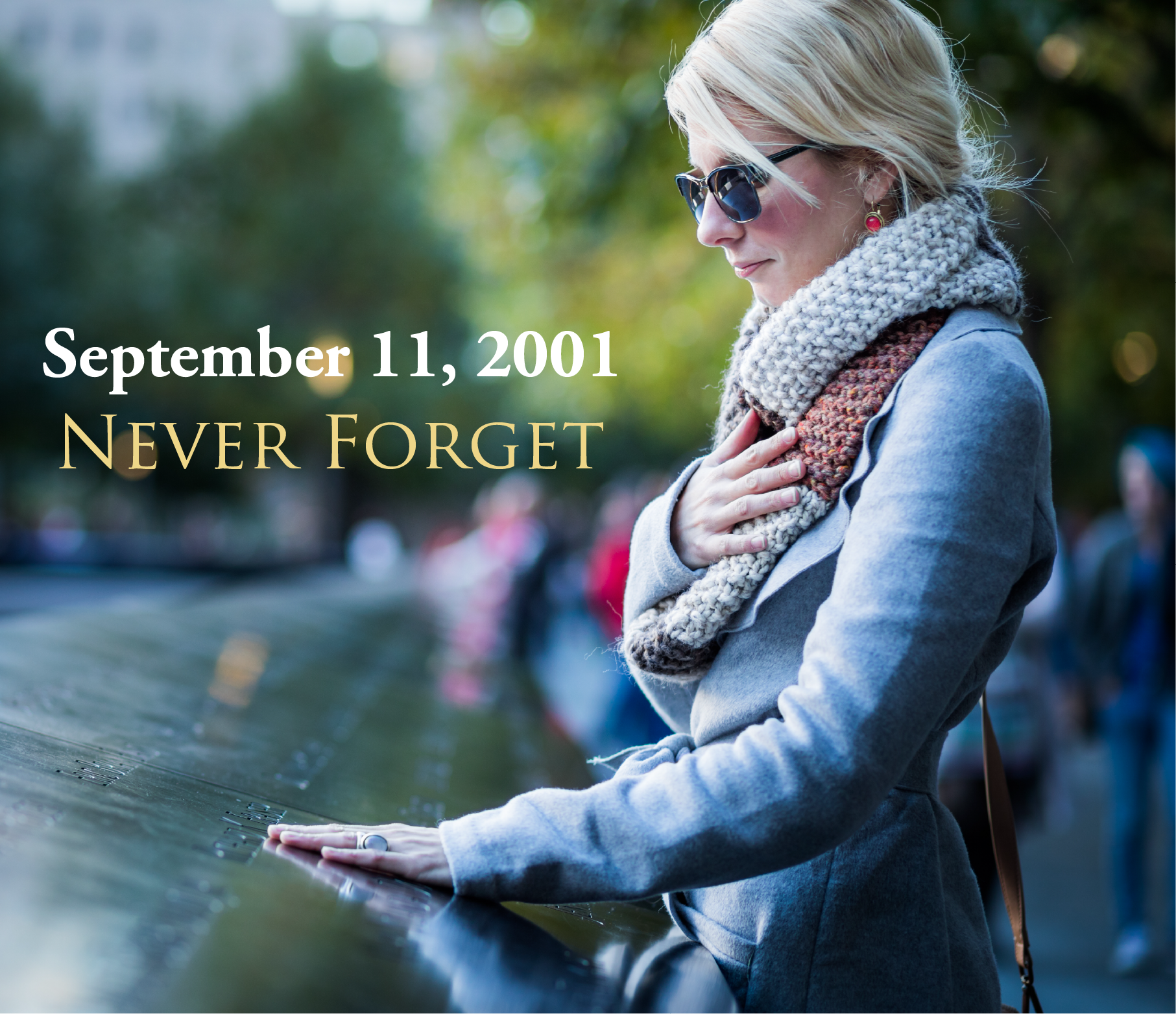 "sad women at 9-11 memorial with ""never forget"" wording on the graphic"